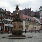 A statue at the Karlsplatz in Heidelberg, the Heidelberg castle in the background