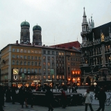 Marienplatz in Munich, the city hall on the right, the cathedral towers on the background