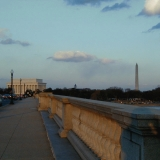The Arlington Memorial bridge, the Lincoln and Washington memorials in the background