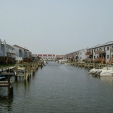 Docks and backyards of houses on the canal