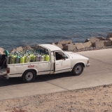 A pick-up truck loaded with compressed air bottles