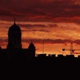 Sun sets behind Helsinki's roofs
