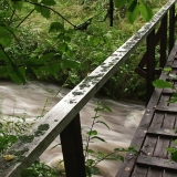 A bridge goes over a flooding creek