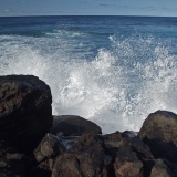 Waves hitting a breakwater