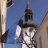 The Estonian flag and the tower of Tallinn cathedral