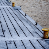 Footprints on a snowy pier