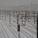 A railway yard during snowfall