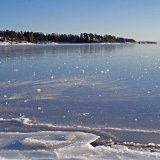 Bunches of ice on a frozen Aurinkolahti bay