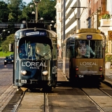 Trams advertising L'oreal passing each other