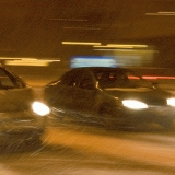 Cars in a blizzard at Mannerheimintie