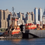 A tugboat and Manhattan skyscrapers