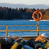 Rocks and a life buoy at the tip of Särkiniemi