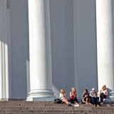 People enjoying a summer day at the steps of the Helsinki cathedral
