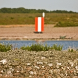 Route marker at a beach