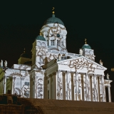 The light installation Heijastuksia - Reflections by Mikki Kunttu illuminates the Helsinki cathedral