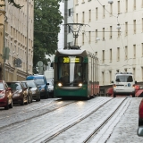 A tram and a police car pass each other at Tehtaankatu