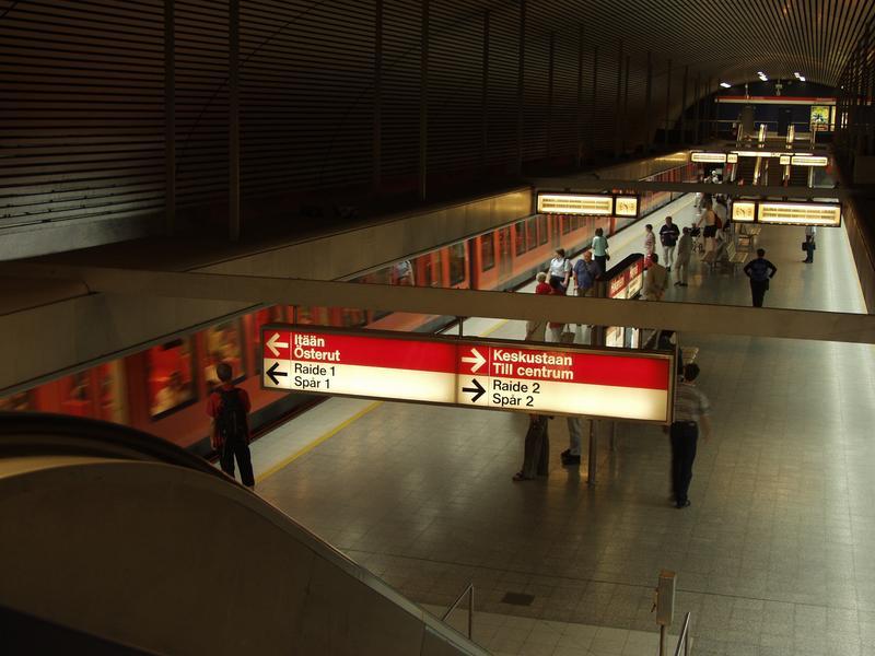 Escalators, the platform and a subway train at the Hakaniemi subway station