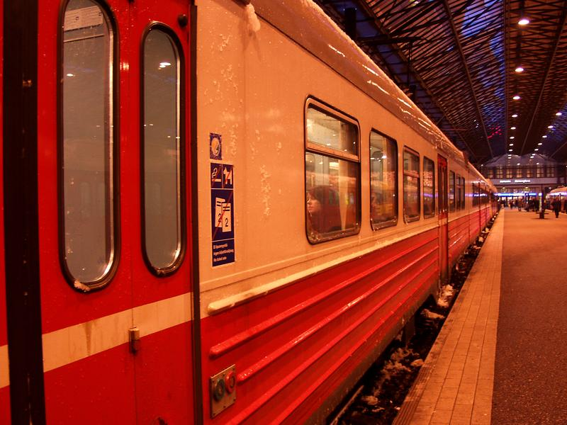 A commuter train waits for departure at Helsinki railway station