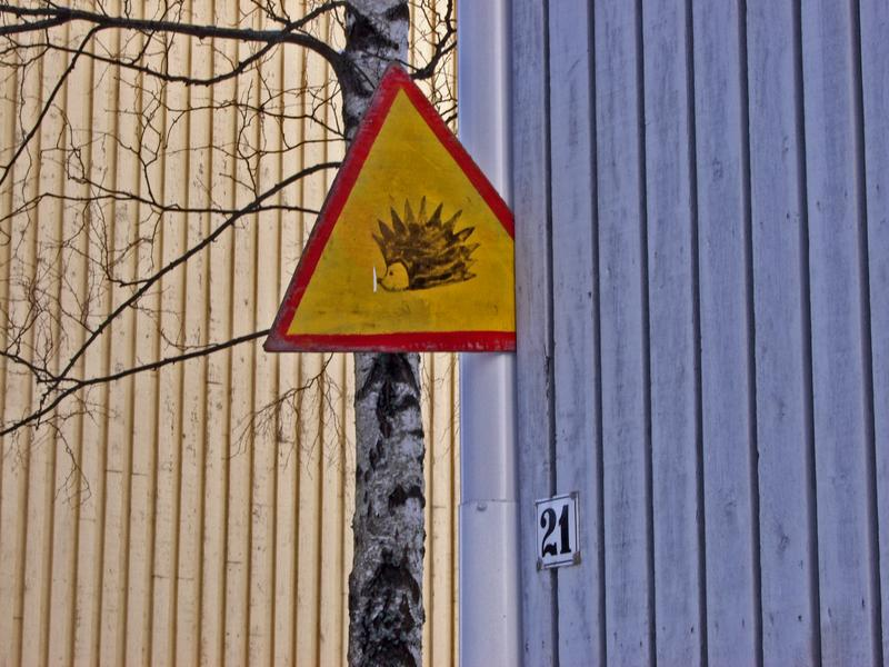 A warning sign for hedgehogs at Limingankatu
