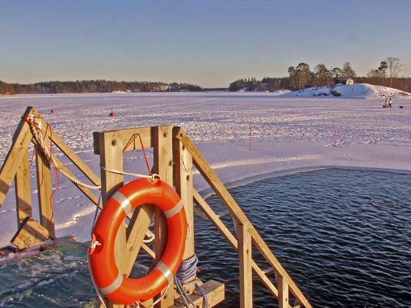 A winter time open water swimming place at Marjaniemi beach, Koivusaari islands in the background