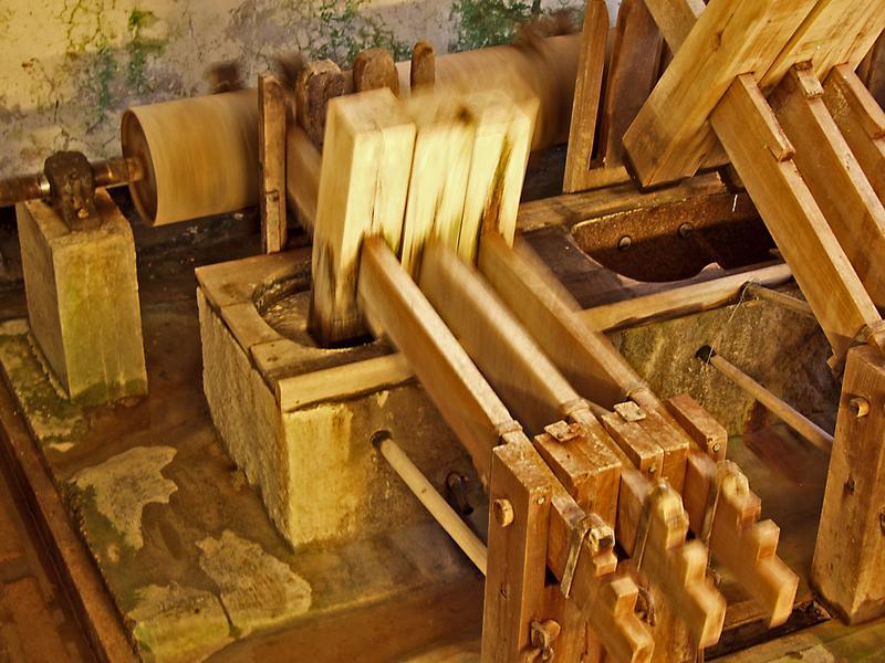 Mallets hammering paper pulp