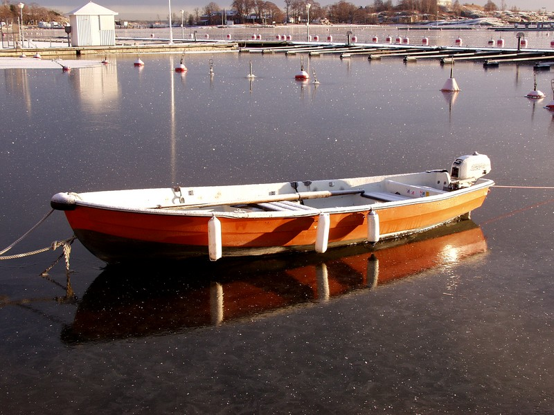 A boat surrounded by ice