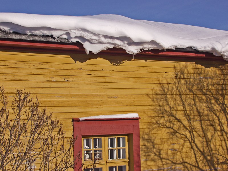Snow on top of a house