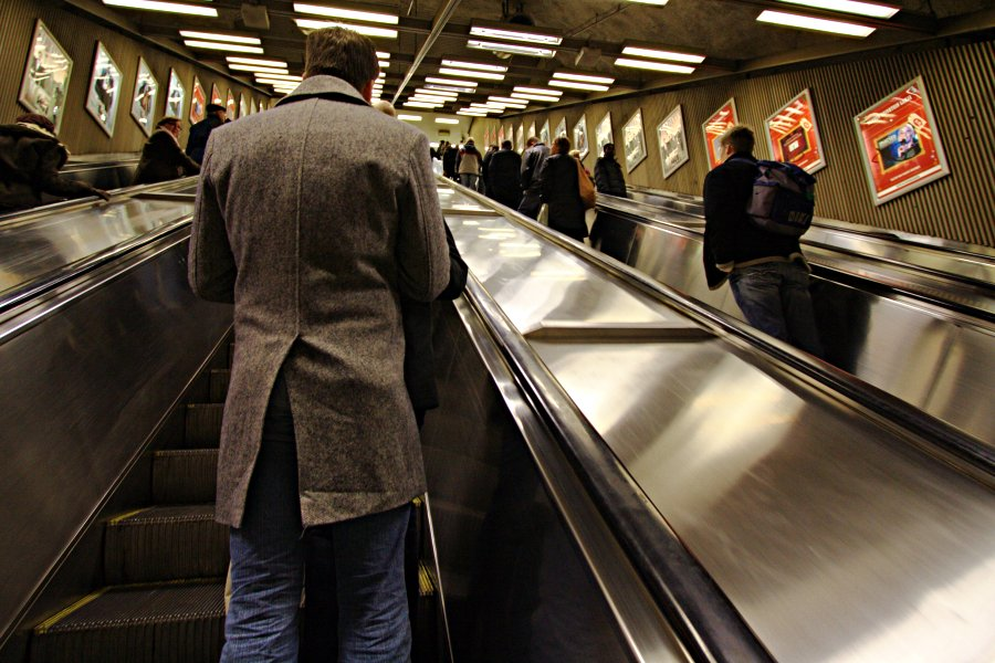 Man on escalator heading to the central railway station