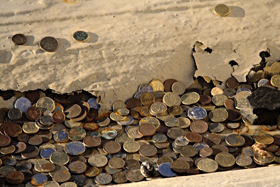 Coins at a rainwater sewer at the top of the Stadium tower