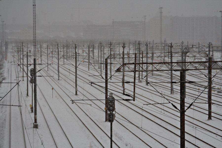 A railway yard during snowfall