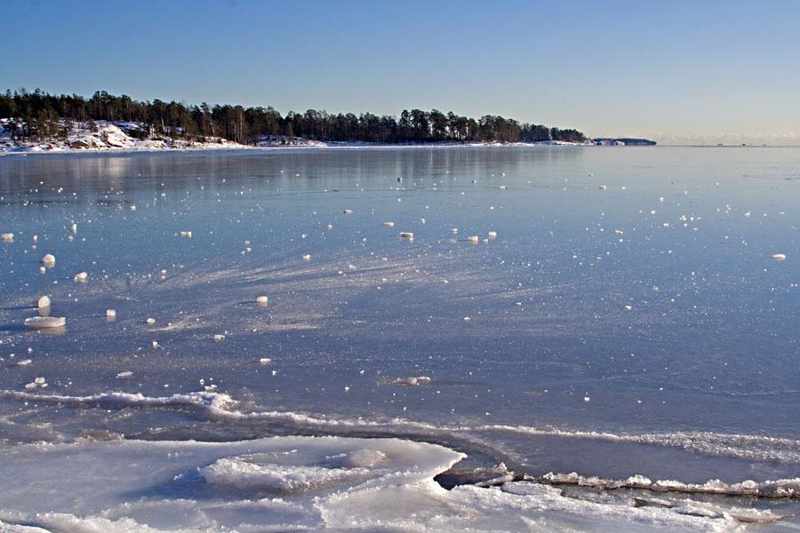 Bunches of ice on a frozen Aurinkolahti bay