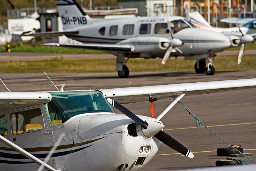 Piper owned by FM-Kartta Oy, a small Cessna in the foreground