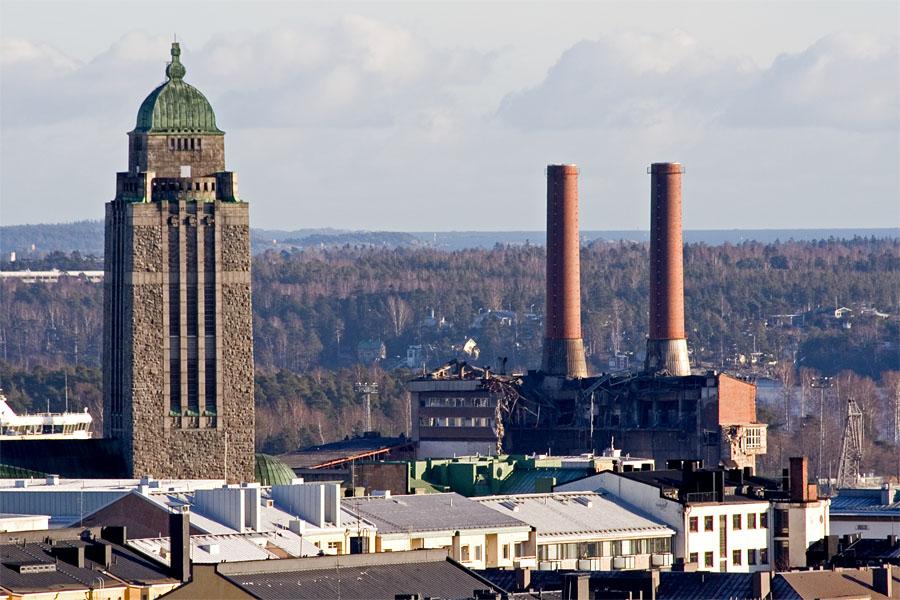 Kallio church bell tower and the power plant at Hanasaari where demolition is underway