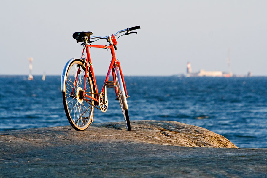 Bicycle on shore rocks