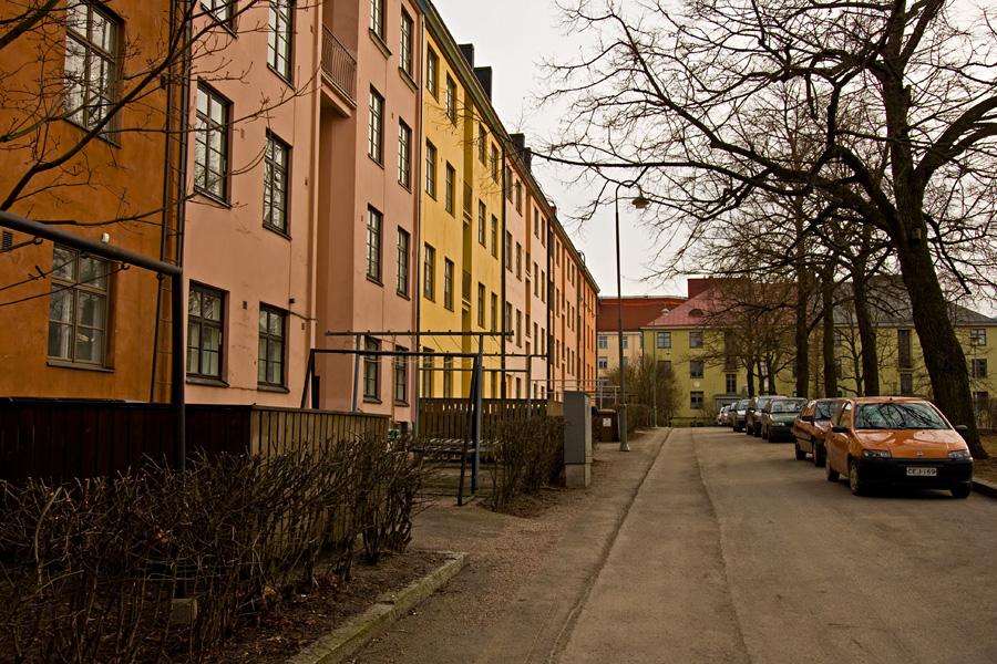 Torkkelinkujan pastellin värisiä taloja