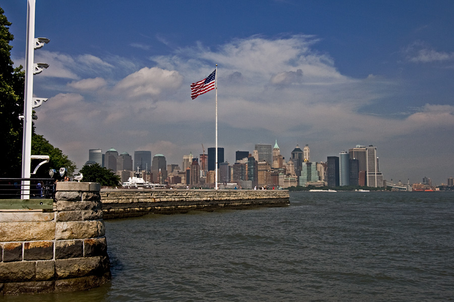 Stars and stripes on Ellis Island, Manhattan in the background