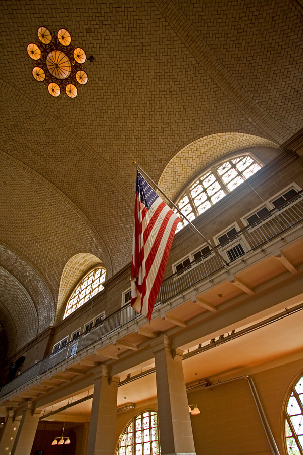 Stars and stripes hanging in a large hall at Ellis Island