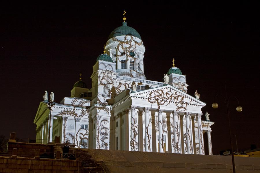 The light installation Heijastuksia - Reflections by Mikki Kunttu illuminates the Helsinki cathedral