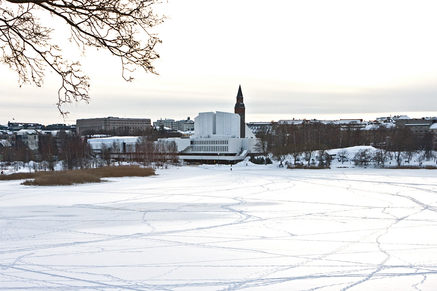 The tower of the national museum of Finland blends to the wall of Finlandia Hall